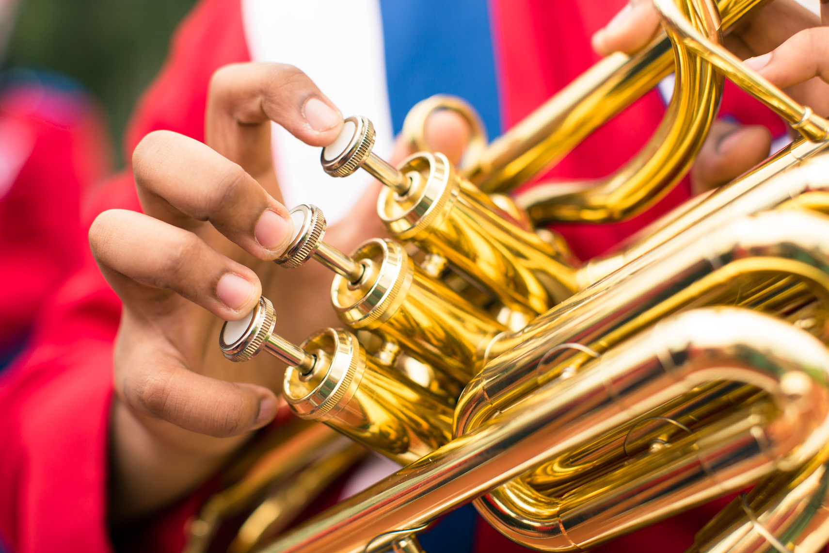 fingers touching trumpet keys for washington dc commercial photography