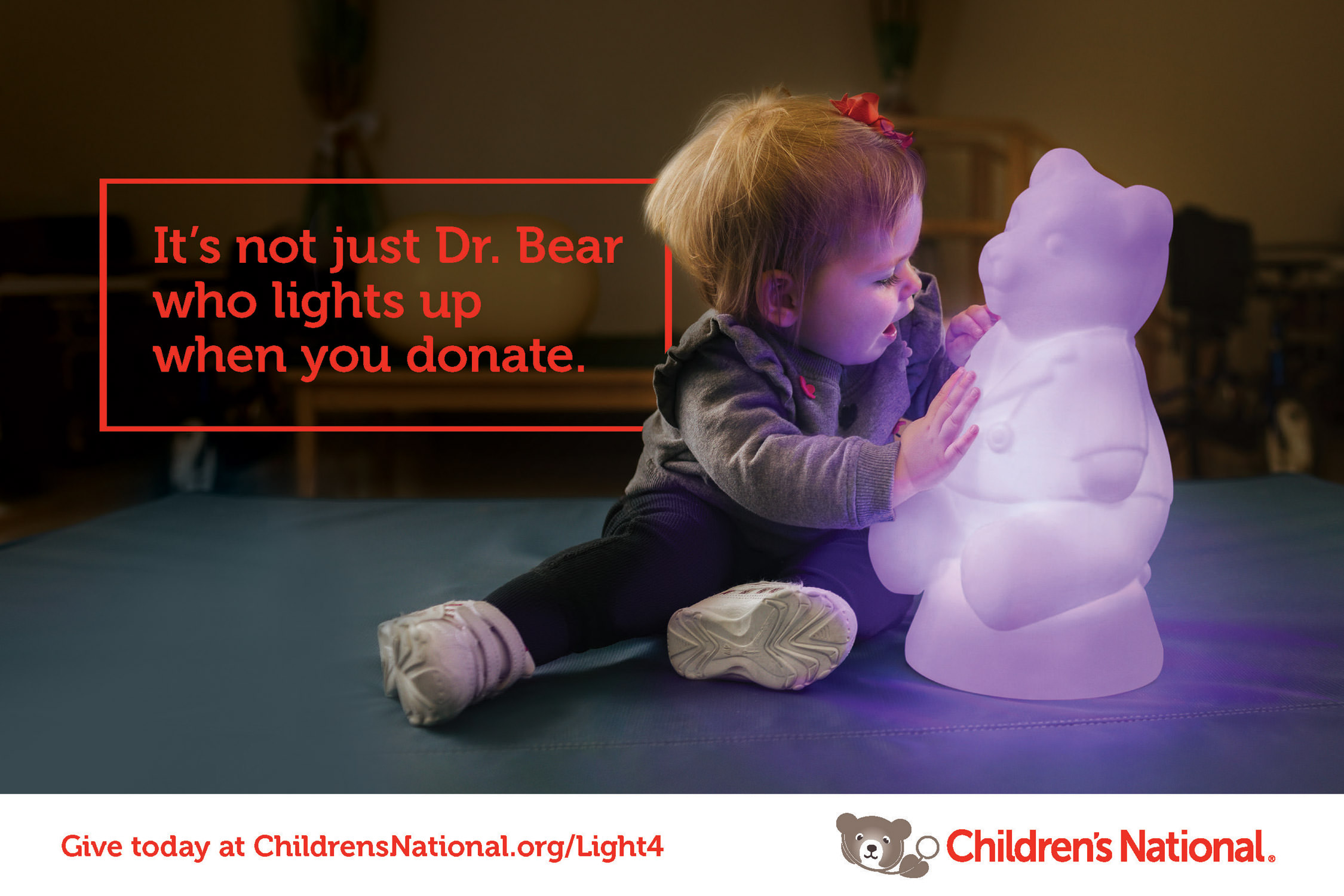 toddler touching glowing bear for children