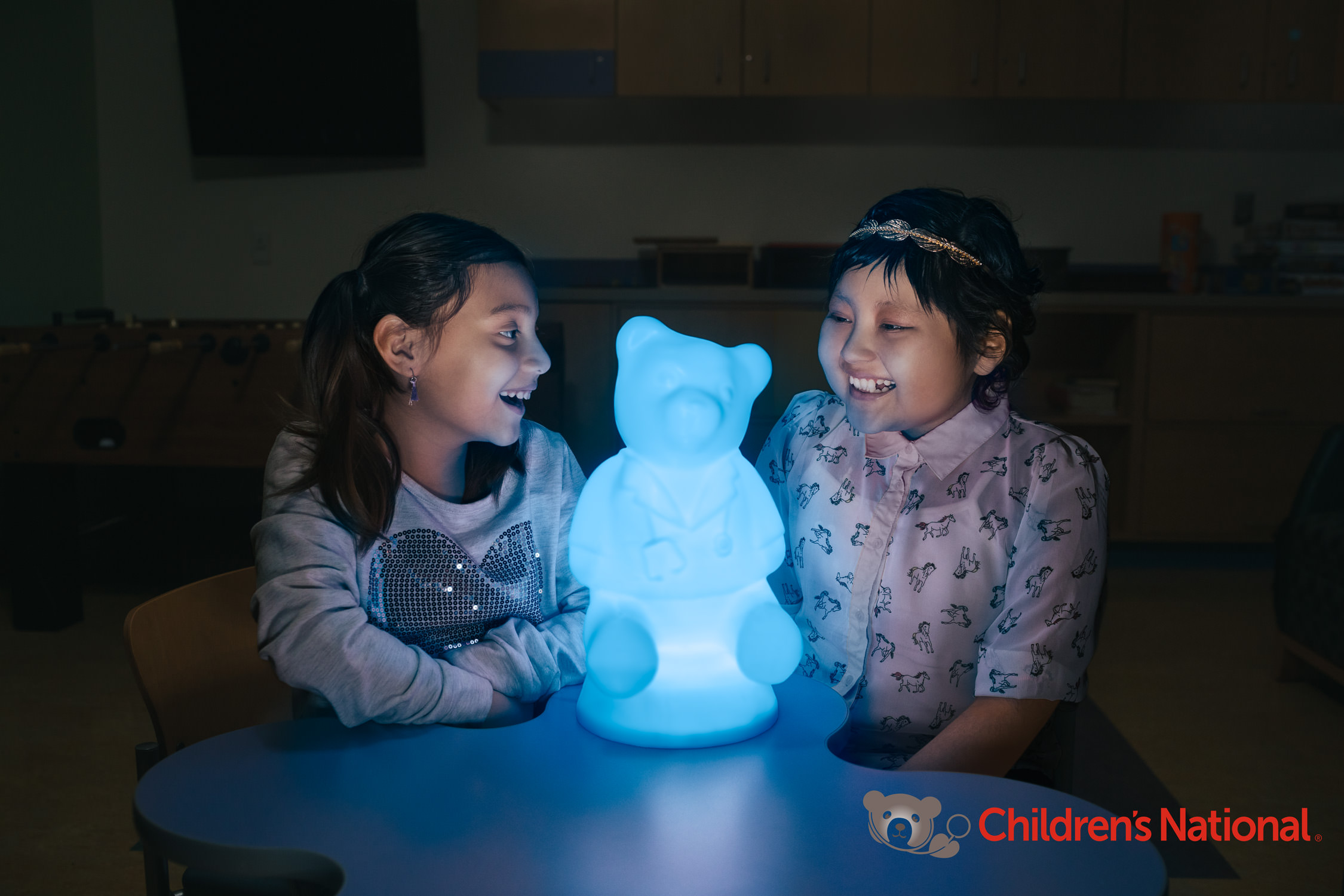 sisters with glowing bear, washington dc commercial photography