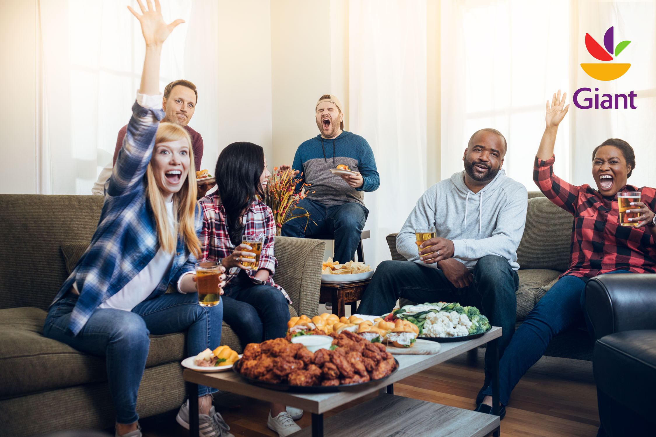 fans cheering while watching football game in living room, washington dc commercial photography
