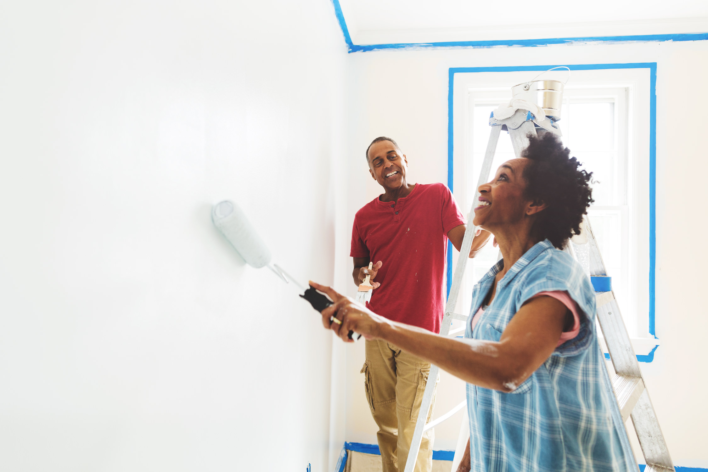 mature couple painting wall for washington dc lifestyle photography