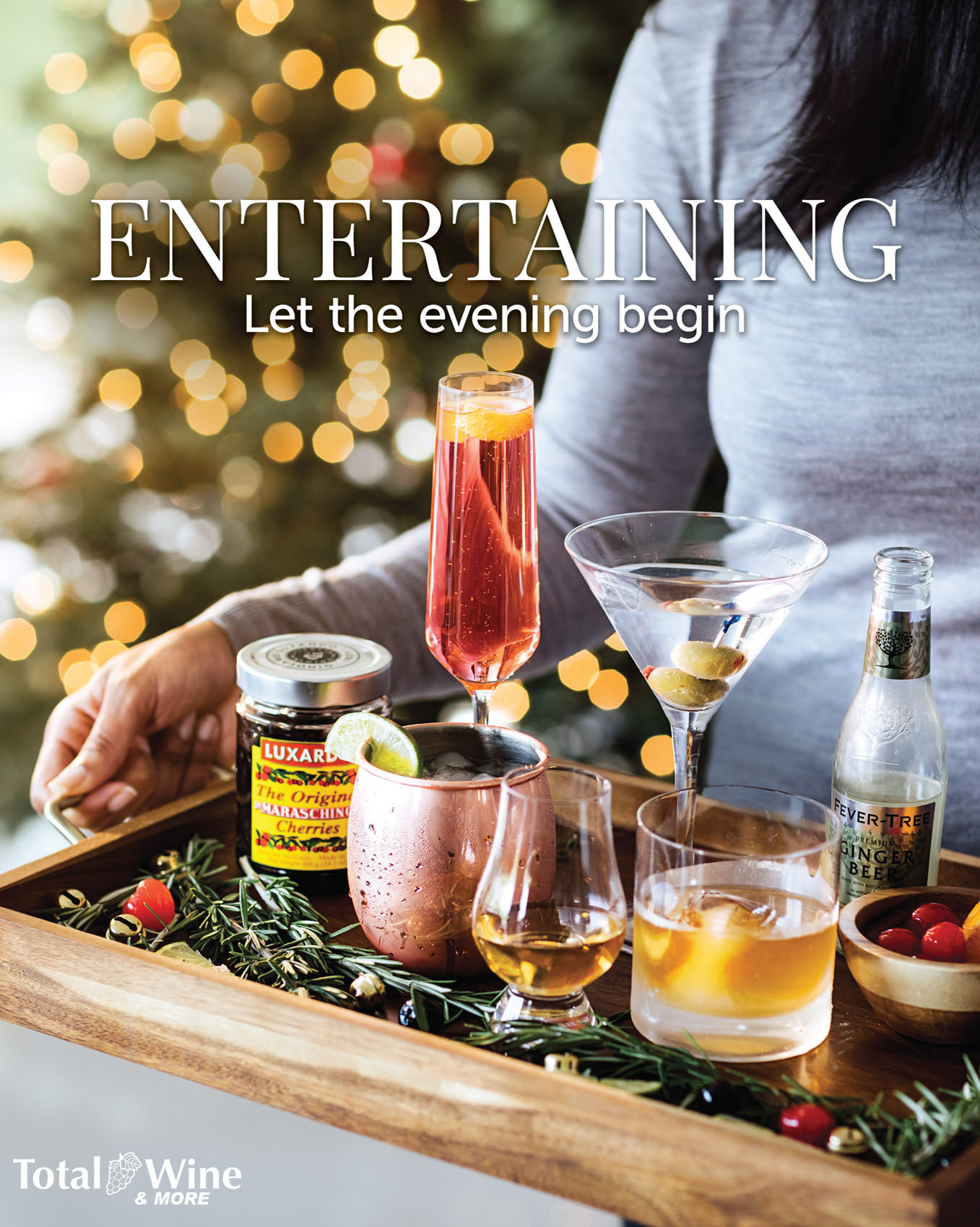hands holding liquors and glasses on tray by christmas tree for total wine & more advertisement, washington dc commercial photography