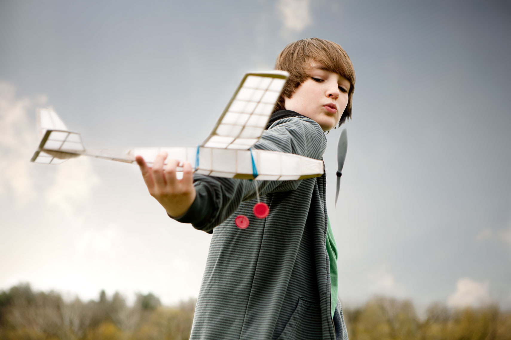 boy flying rubber powered model airplane for washington dc commercial  photography