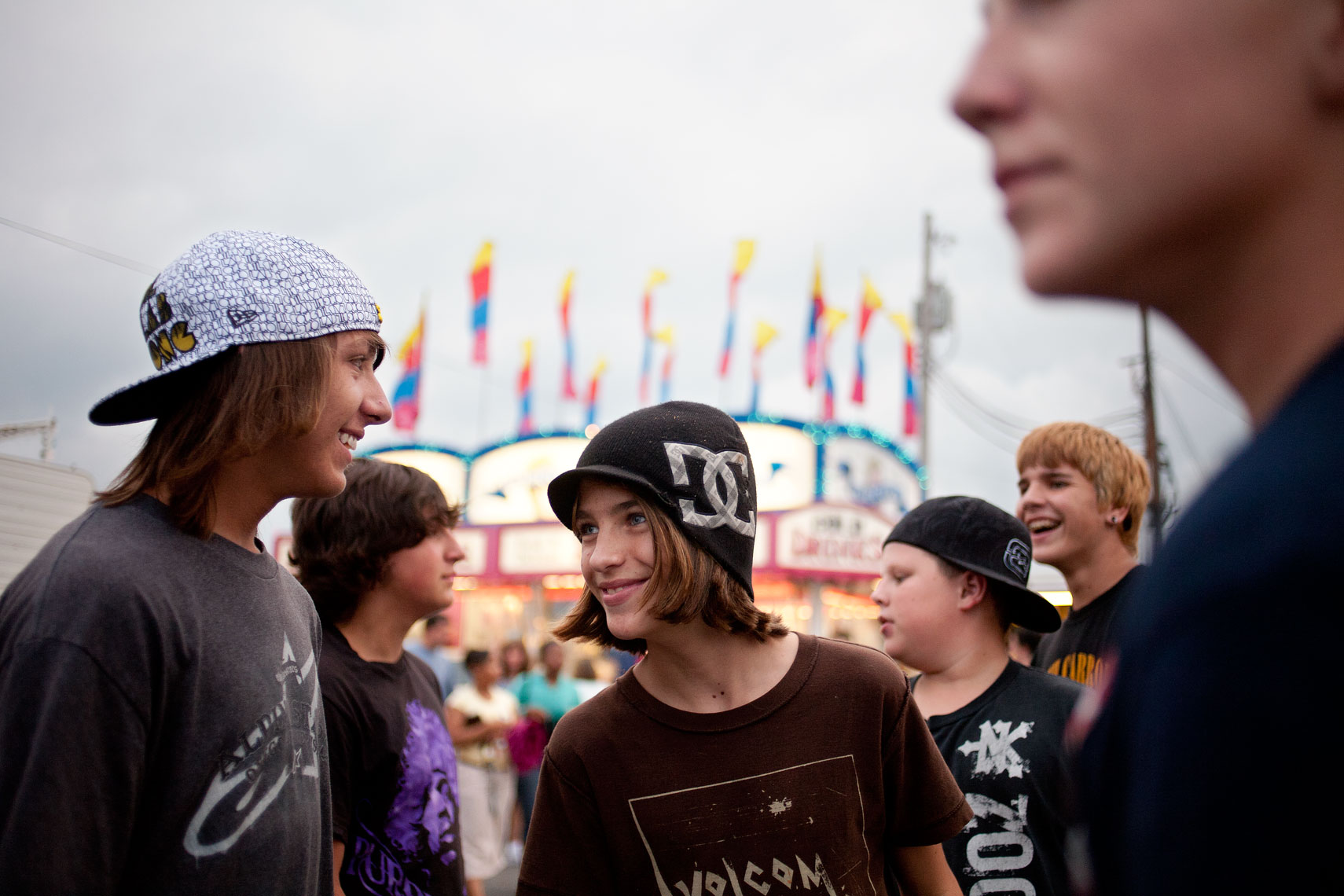 tween boys hanging out at carnival for washington dc editorial photography
