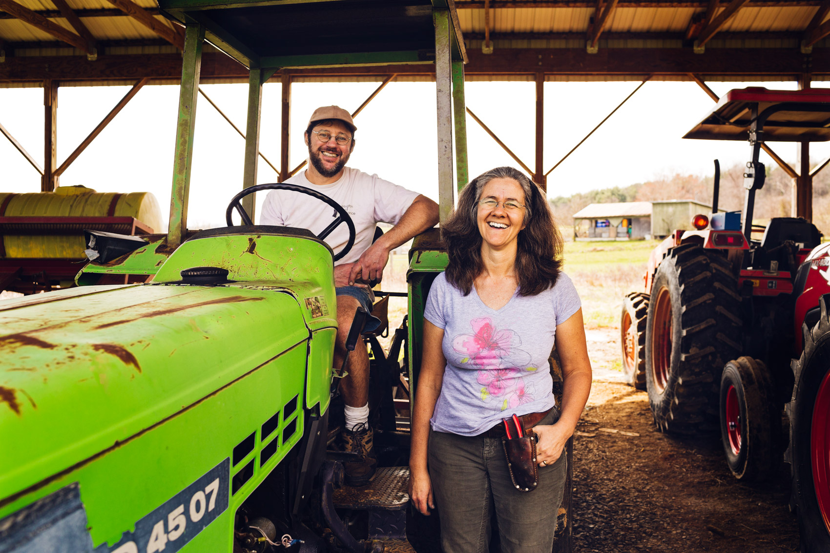 farmer couple posting with tractors for washington dc editorial photography