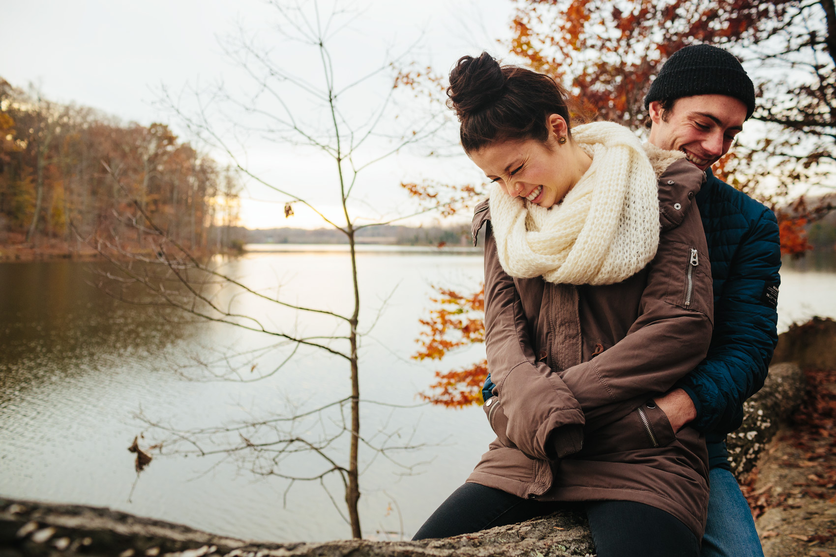 young lovers embracing by a lake for washington dc lifestyle photography